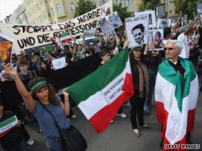 Iranian expatriates protest the June 12 presidential election results on Sunday in Berlin, Germany.