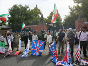 Iranian police stand guard Tuesday outside the British Embassy in Tehran during a protest.