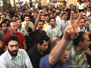 Iranian opposition supporters shout slogans during a gathering in Tehran on Sunday.