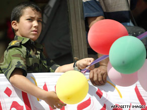 An Iraqi boy watches a parade to mark the withdrawal of U.S. troops from Iraqi cities and towns on Tuesday.
