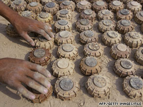 Landmines are laid out after being turned in at an Iraqi police station in 2004.