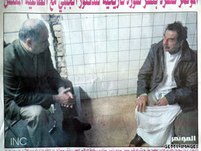 Baghdad's Al Mutamar newspaper shows Saddam Hussein, right, with Ahmed Chalabi of Iraq's governing council in 2003.