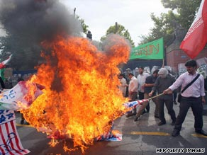Iranian hardline students burn U.S. and British flags outside British embassy in Tehran on June 23.