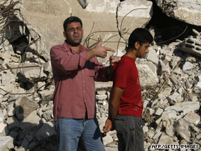 Palestinian Majid Abed Raboh, left, shows Wednesday how he says Israeli soldiers used him as a human shield.