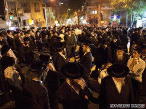 Ultra-Orthodox Jews protest an arrest and the opening of a parking lot on the Sabbath in Jerusalem on Thursday.