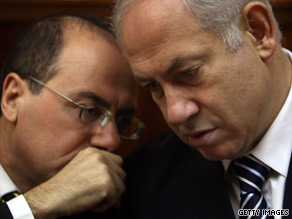 Israeli PM Benjamin Netanyahu consults with an advisor regarding the controversial construction project.