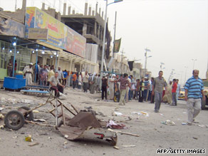 A sandwich stall is among the debris scattered in a street after a twin blast Tuesday in Baghdad's Sadr City.