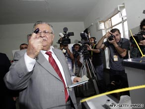 Iraqi President Jalal Talabani, a Kurd, shows off his ink-stained finger as he votes in Sulaimaniyah.
