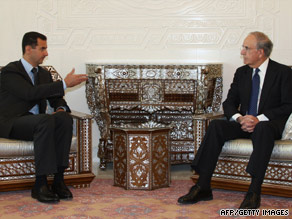 After meeting with al-Assad, Mitchell greets Ehud Barak, Israel's defense minister, before their meeting in Tel Aviv.