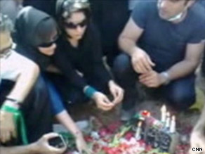 Mourners gather around the grave of Neda Agh-Soltan in Beheshte Zahra Cemetery.
