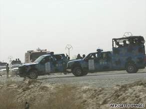 Iraqi police block entrances to Camp Ashraf in Diyala province on July 29.