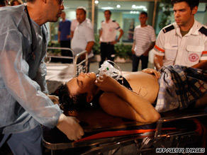 A man injured in the shooting at the club in Tel Aviv receives treatment.