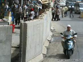 The walls split Baghdad along sectarian lines, shielding some from Shiite militias and Sunni insurgents.
