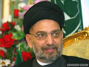 Al-Hakim, right, shakes hands with Iranian President Mahmoud Ahmadinejad in Tehran, Iran, in 2007.