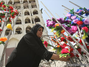 Violence has spiked recently in Iraq. Flowers adorn the blast crater of the destroyed Foreign Ministry building.