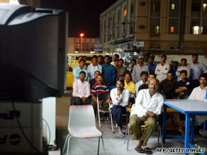 Men gather to watch TV after breaking their fast in Manama, Bahrain.