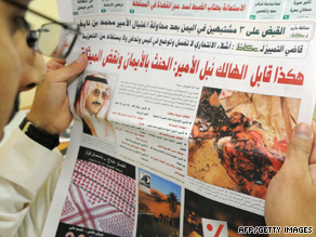 A Saudi man reads a newspaper featuring a front-page story on Thursday's attack.