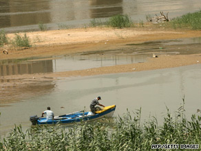 Iraqi fishermen ride their motor boat in the waters of the Tigris River in Baghdad.