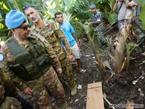 Italian soldiers with UNIFIL and Lebanese security forces inspect a rocket site in Qlayleh, Lebanon, on Friday.