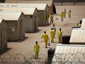 Iraqi detainees walk around Camp Bucca detention centre on May 20, 2008