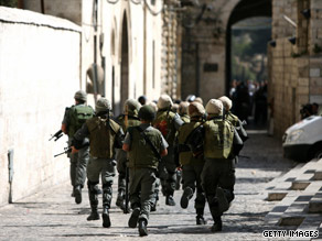 Israeli border police charge towards Palestinian protesters during clashes in Jerusalem's Old City.