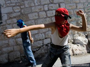 Palestinian youths throw stones at  Israeli security forces, which tried to disperse them in East Jerusalem.