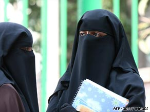 Cairo University students wearing niqab stand outside a university dormitory on Oct. 7 unable to enter due to the new rules preventing admission to niqab wearers.