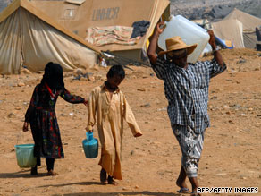 A family fetches water at a camp for displaced persons in northwest Yemen late last week.