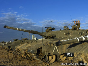 An Israeli soldier sits on a tank on the Israel-Gaza border just before fighting began in December 2008.
