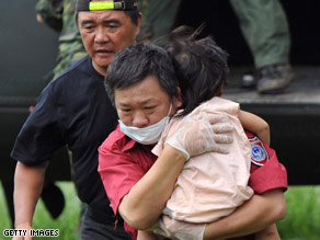 A woman whose family was unaccounted for appeals for rescue Monday in southern Taiwan.