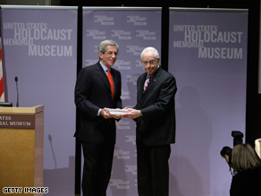 U.S. Attorney General Michael Mukasey (R) and Fred Zeidman (L), Chairman of U.S. Holocaust Memorial Museum, in Washington, DC. The Department of Justice has donated copies of its records against alleged Nazi war criminals living in the U.S.