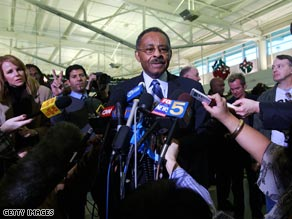 Roland Burris spoke with reporters Monday before getting on a flight bound for Washington.