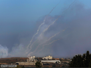 Palestinian Qassam rockets are fired by Hamas militants inside the Gaza Strip towards the Israeli town of Sderot on Tuesday, as seen from Israel's border with the Palestinian territory.