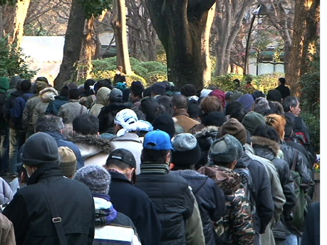 A construction worker joined a long line of people waiting for a hot meal in Tokyo's Hibiya Park.