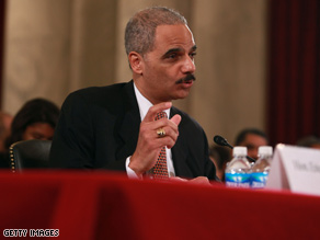 Attorney General designate Eric Holder discussed a federal wiretap law during his confirmation hearing Thursday.