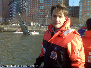 CNN's David Mattingly on a Coast Guard boat by New York's Battery Park in front of the downed plane.