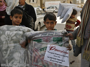 Children in Gaza receive humanitarian aid from a Mercy Corps delivery.