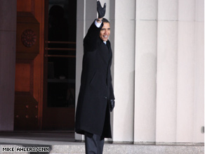President-elect Obama waves to the crowd from the steps of Baltimore's City Hall Saturday evening.