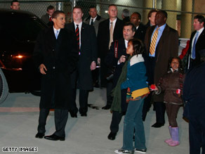 President-elect Obama collected his daughters after detraining in Washington Saturday evening.