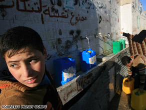 Children in Gaza fill water containers during the cease-fire.