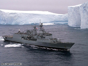 A New Zealand frigate patrols past the Ross Ice Shelf in the Southern Ocean in Antarctica.