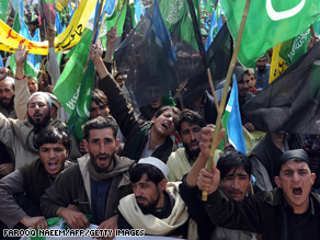 Tribesmen and activists of Pakistani Islamist party, Jamaat-i-Islami, shout during a demonstration in Islamabad on January 23, demanding an end to Pakistan military operations and US missile attacks against Taliban militants in lawless areas bordering Afghanistan.