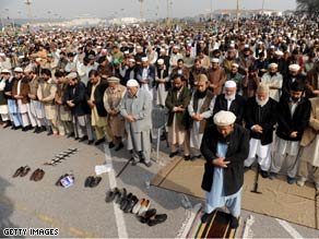Protesters prayed outside the Pakistani parliament building after holding a protest over U.S. missile strikes in Pakistan.