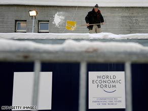 A worker clears away snow ahead of the Davos 2009 forum.