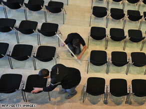 Workers install chairs at the Davos Congress Center in advance of the opening of the World Economic Forum.