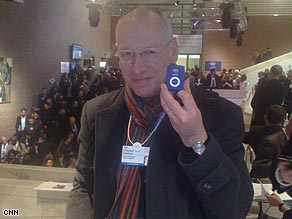 Charles Hodson shows off his Davos pedometer.