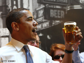 Above: Obama lifts a cold one during the campaign season.