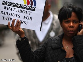  A woman holds up a sign near Wall Street on September 22, 2008, in New York City.