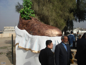 This monument to the shoe thrown at former Pres. George W. Bush was taken down one day after being unveiled in the Tikrit region of Iraq.