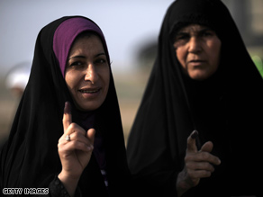 Two Iraqi women display their ink-stained fingers, a sign that they voted Saturday in Iraq&#039;s provincial elections.